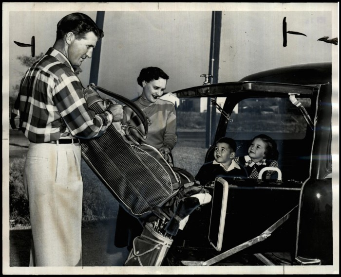 Duffy, his wife, and two children leaving for a golf tournament in 1952.